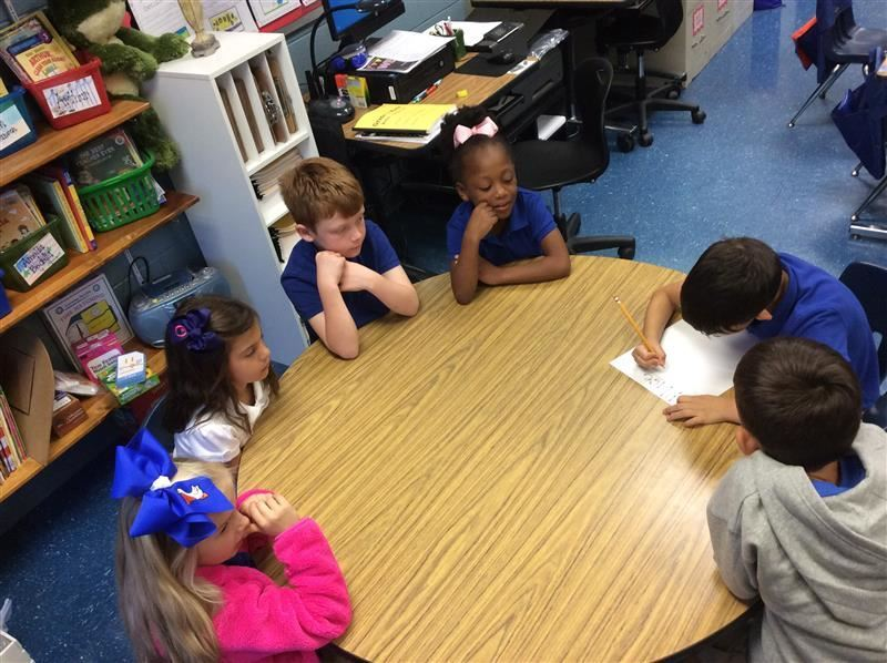 Students participating in Round Table writing and discussion activity.
